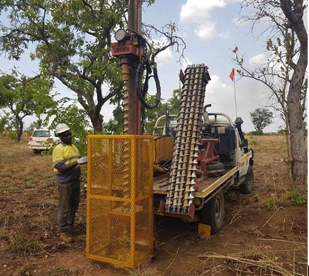 Vehicle mounted auger drilling unit.