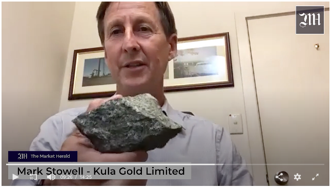 Chairman Mark Stowell displaying a recent rock finding from Kula's Brunswick Project